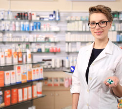 female staff with medicines in her hand